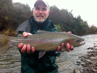 Joe holding a rainbow trout