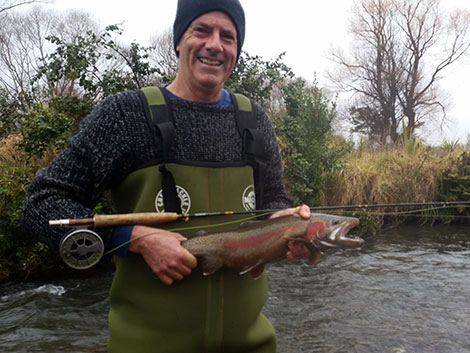 Karl holding a rainbow trout