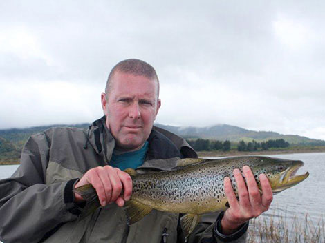 Graham Davidson with a beautiful brown trout in scenic New Zealand