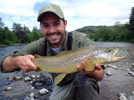 Matt with a beautiful brown trout in scenic New Zealand